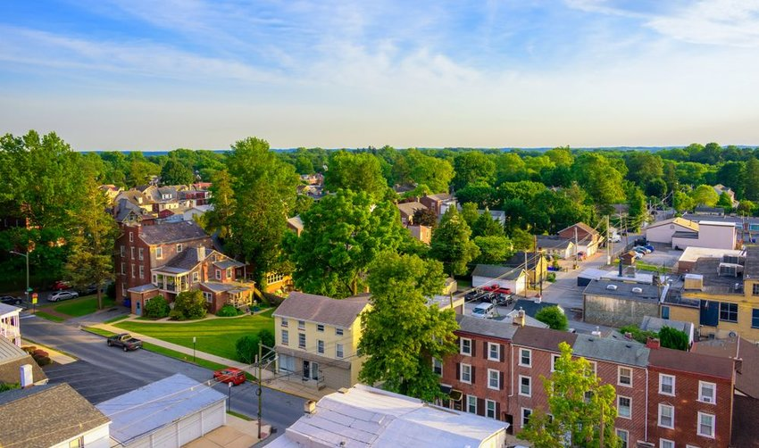 Aerial view of town in Pennsylvania showing lush greenery and buildings