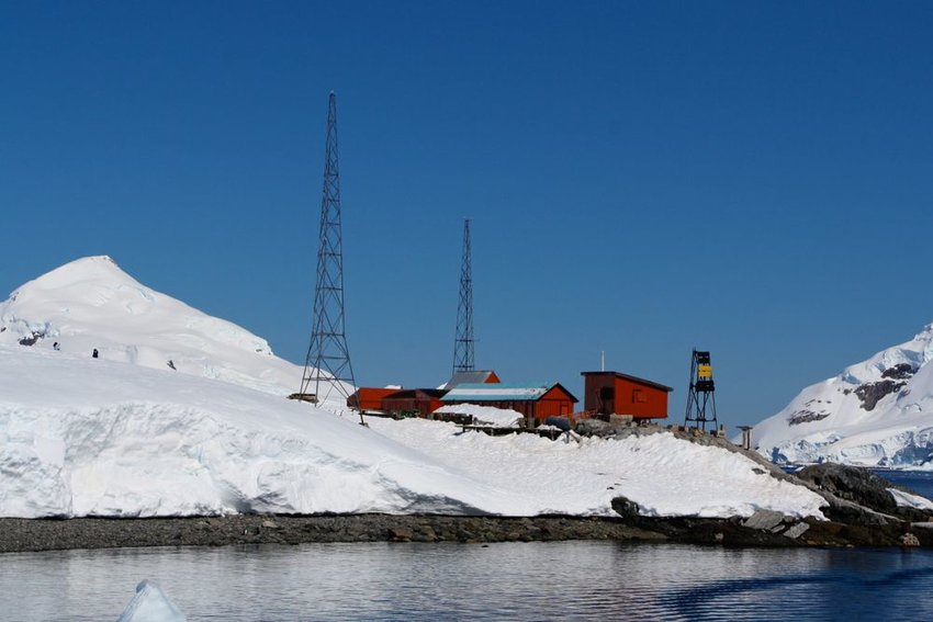 Modern research outpost in Antarctica with storage facilities and radio towers