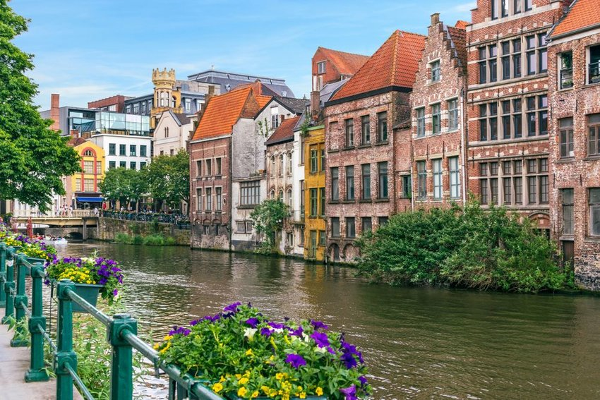 Waterway and flowers in Belgium city of Ghent on a clear day