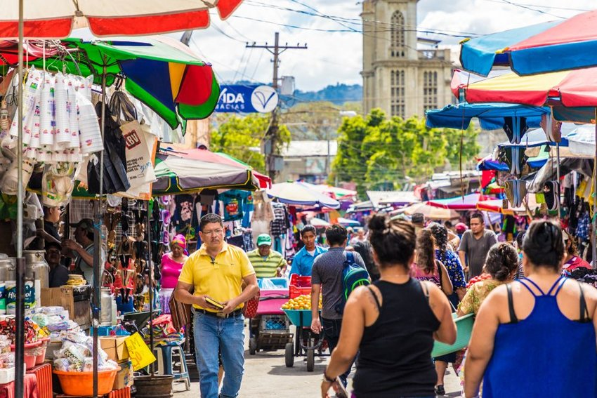 Street view of crowds and locals on a busy market in San Salvador, El Salvador