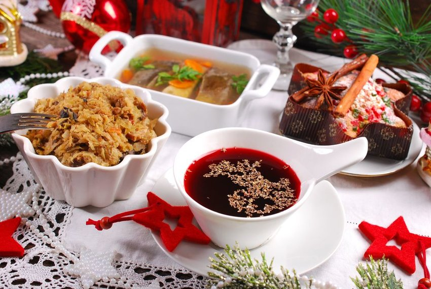Table set with various dishes and soups on Christmas Eve, a traditional Polish Wigilia