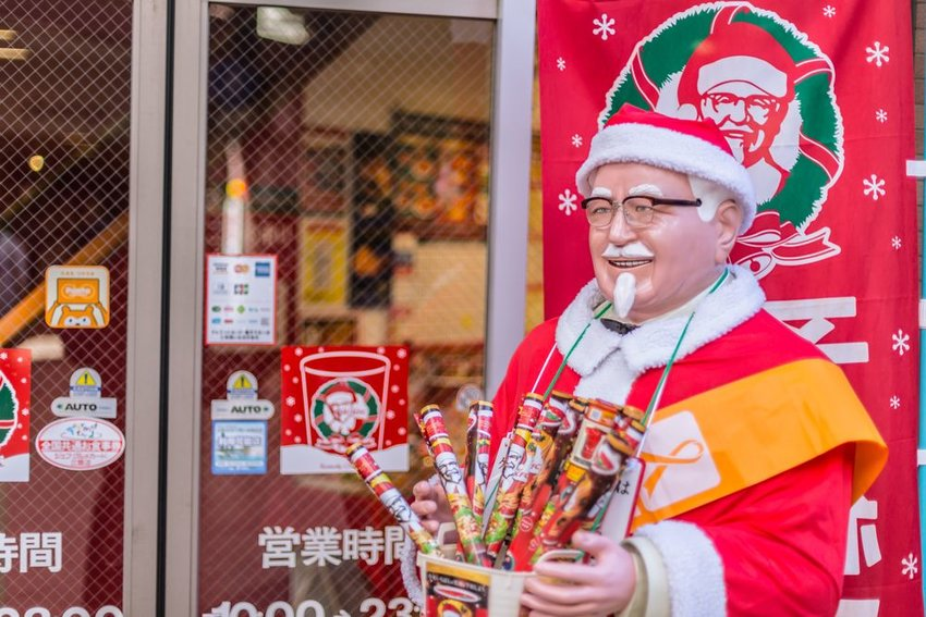 Kentucky Fried Chicken storefront in Osaka, Japan featuring Christmas promotional materials
