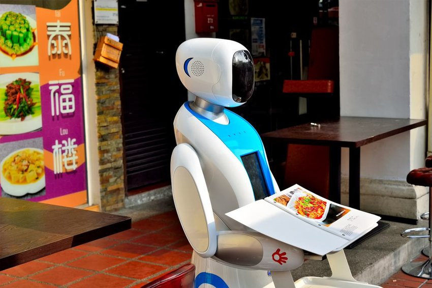 Restaurant in Singapore with a white, automated robot server to take customer orders