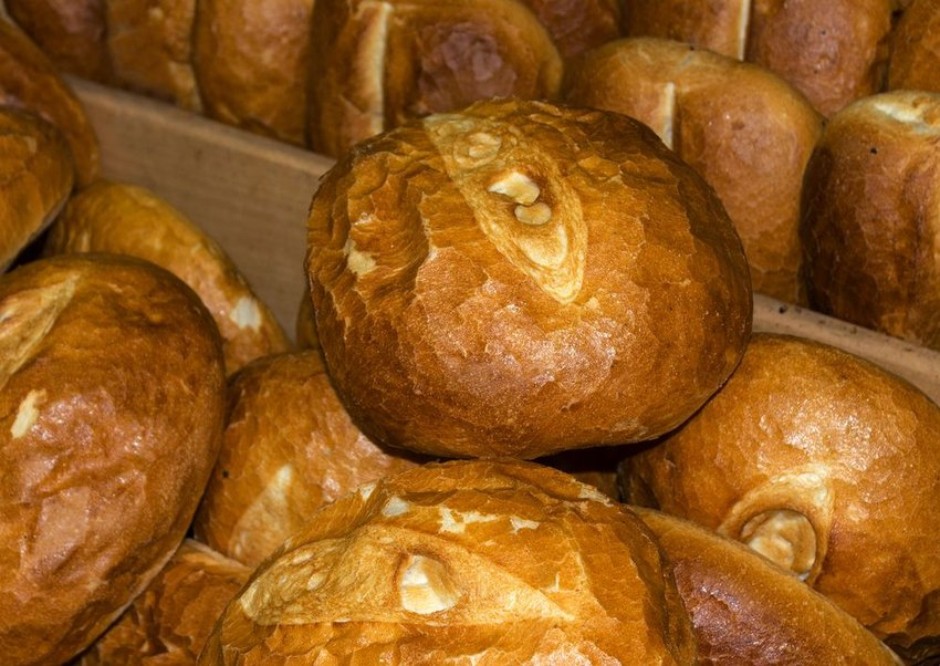 Up close view of traditional Armenian bread loaves stacked in bins for sale