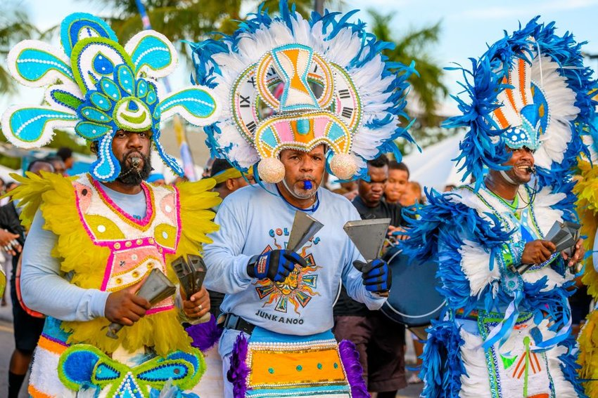 Group of revelers dressed in colorful costumes for a Bahamas Junkanoo parade celebration