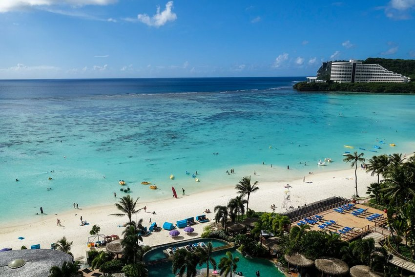 Aerial view of sandy white beach and blue waters in Guam