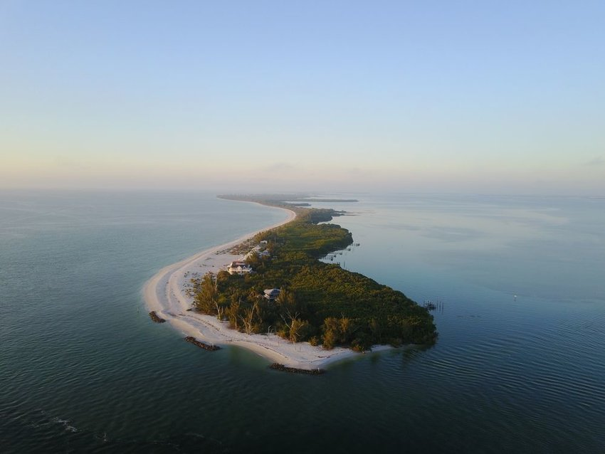 Aerial view of small green Sanibel Island off the coast of Florida