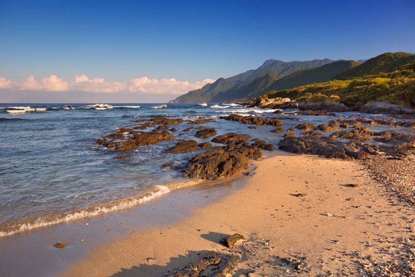 Beach on Yakushima Island, Japan with mountains in distance