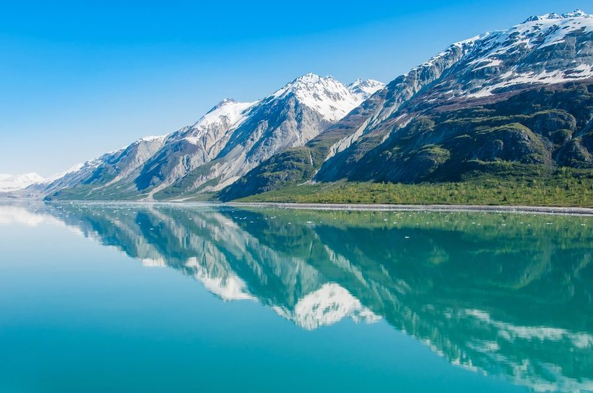 Mountains reflecting in water in Glacier Bay in Alaska