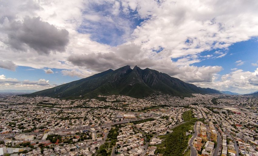 Northern Mexico cityscape near Nuevo Leon under scattered clouds