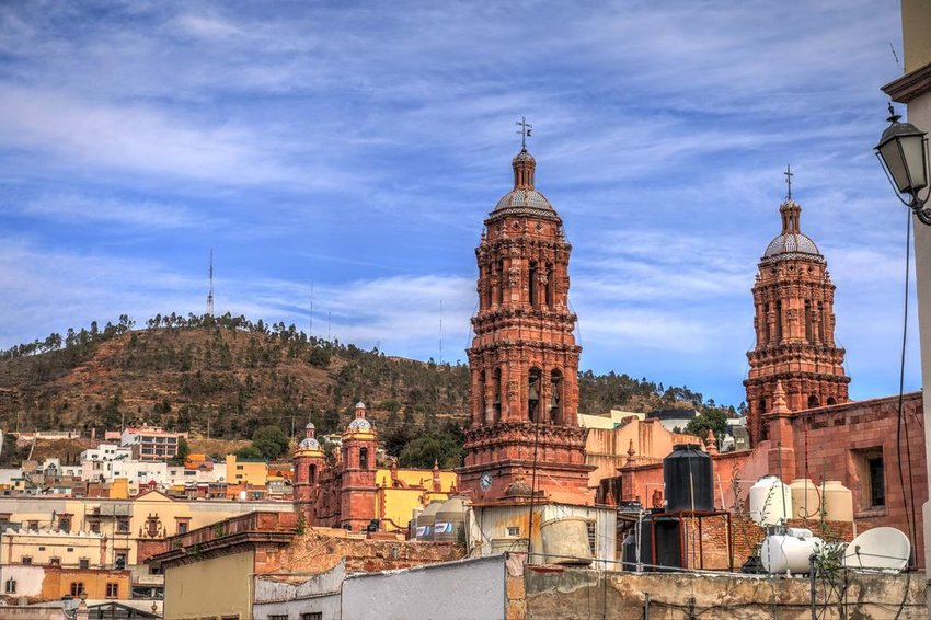 Aerial view of town buildings and large cathedral towers in Zacatecas, Mexico