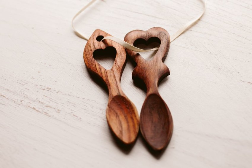 Traditional Welsh love spoons carved from wood in heart shapes