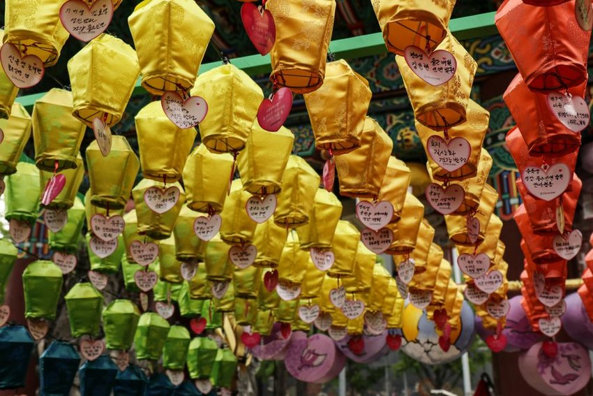 Rows of colorful lanterns in South Korea with Valentine's Day notes attached