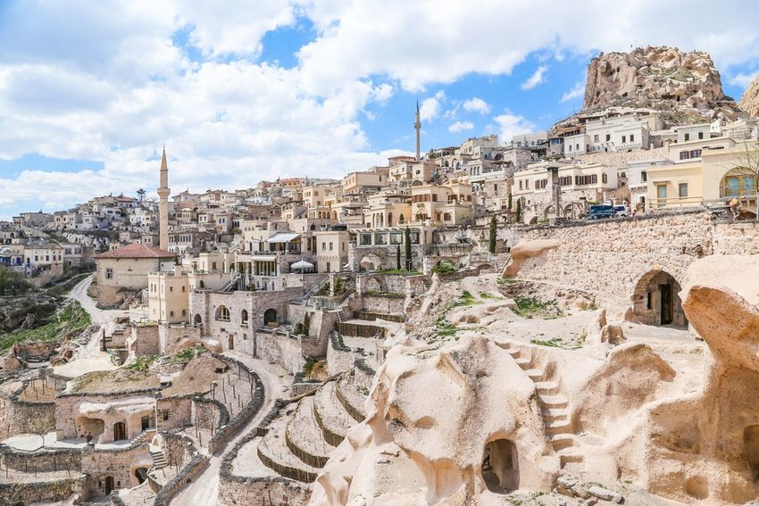 Aerial view of sprawling rocks and old buildings in Turkish region of Cappadocia