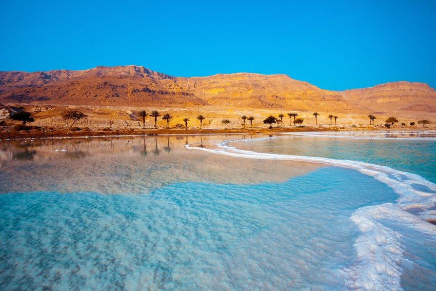 Dead Sea lake in Jordan showing glassy waters and rocky outcroppings