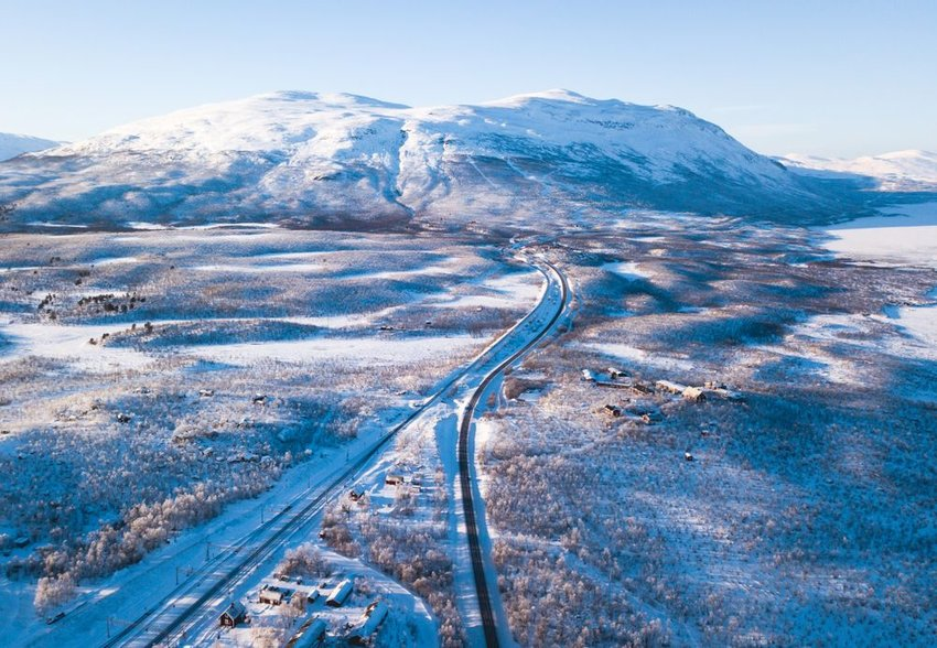 Aerial view of snowy landscape in Abisko National Park on a clear day, Sweden