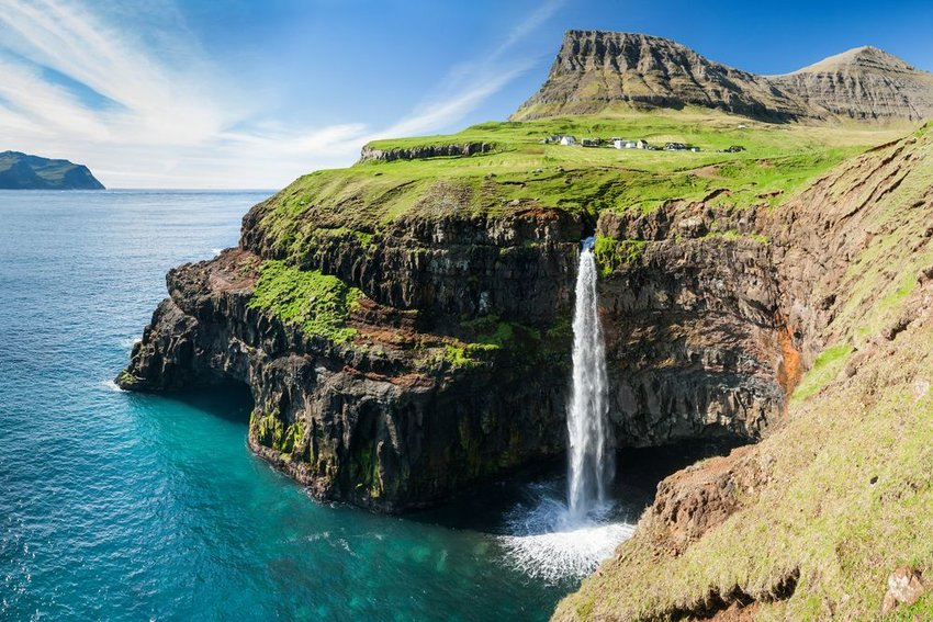 Aerial view of waterfall and cliffs on the Faroe Islands, seen on a clear day