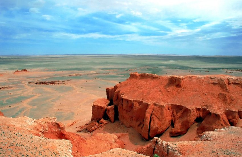 Aerial view of Gobi landscape showing dry, barren rocks and red sands