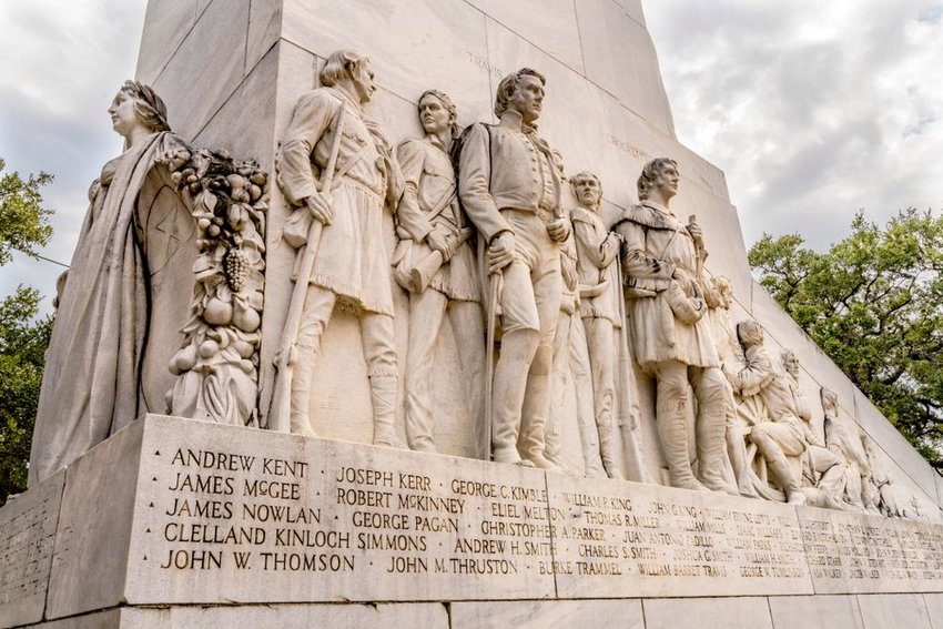 Alamo memorial statue with names of fallen soldiers
