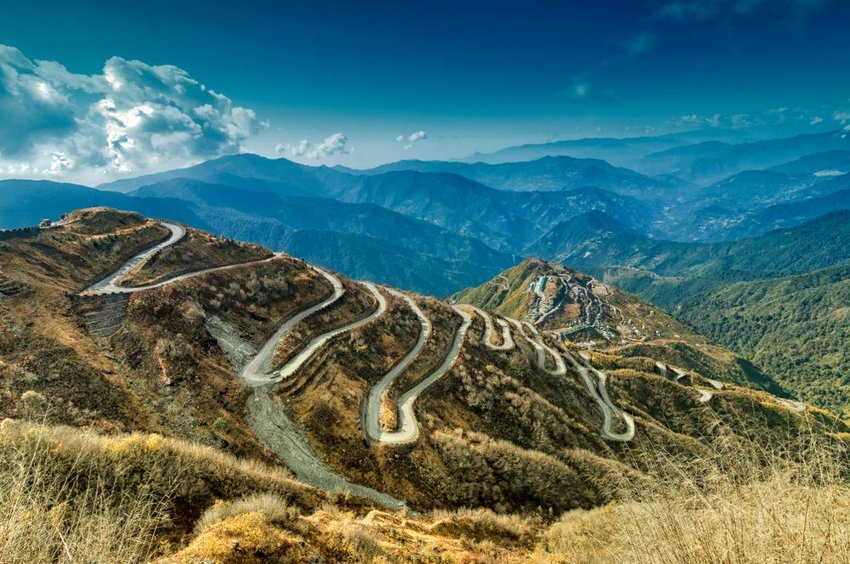 Aerial view of iconic Silk Road route winding down mountainside