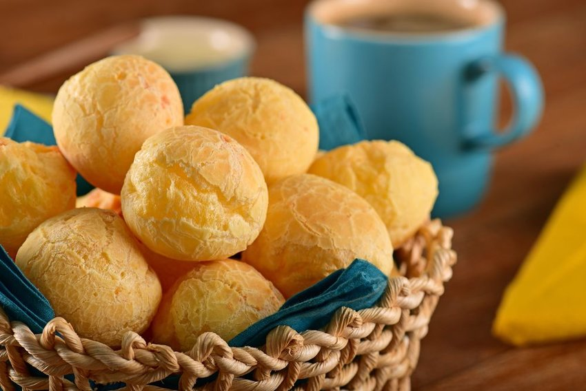 Pão de queijo cheese ball puffs placed in a serving basket