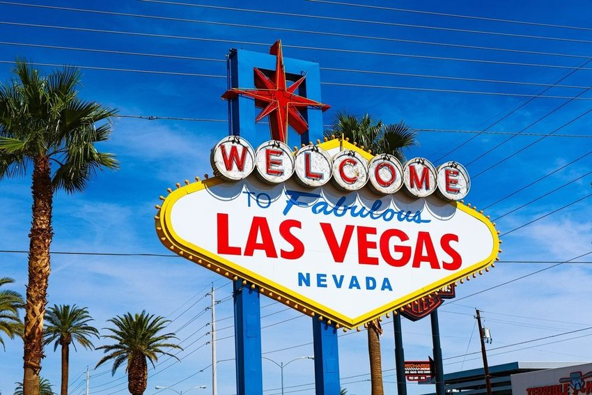 Iconic welcome sign for Las Vegas, Nevada with trees and power lines