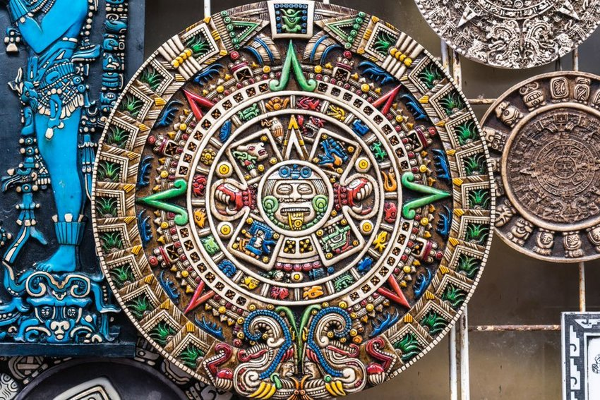 Large colorful wheel with Mayan symbols, antique calendar system