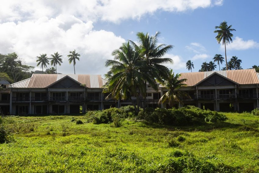 Closed down Sheraton Rarotonga with palm trees and greenery