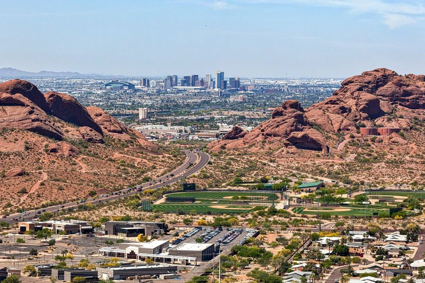 Aerial view of Phoenix, Arizona showing red rocks and distant skyscrapers