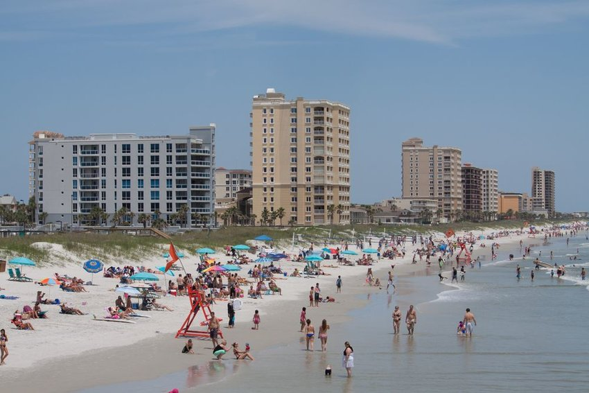Aerial view of Jacksonville beach with crowds of people in water, Florida