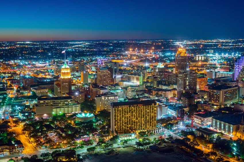 Aerial view of brightly lit cityscape, seen at night in San Antonio, Texas