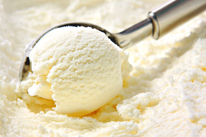 Up close view of vanilla ice cream being scooped