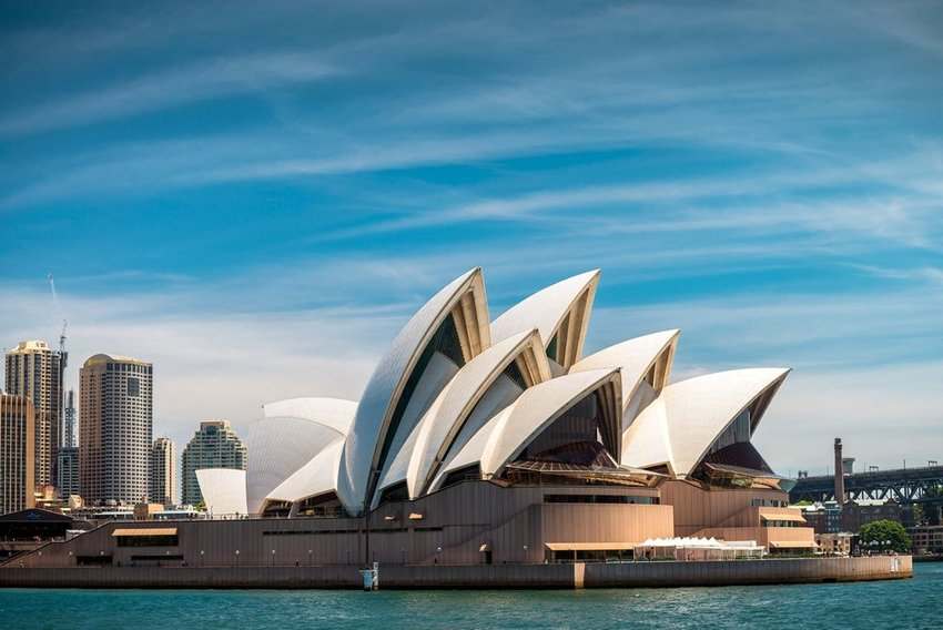 Iconic Sydney Opera House architecture under scattered clouds