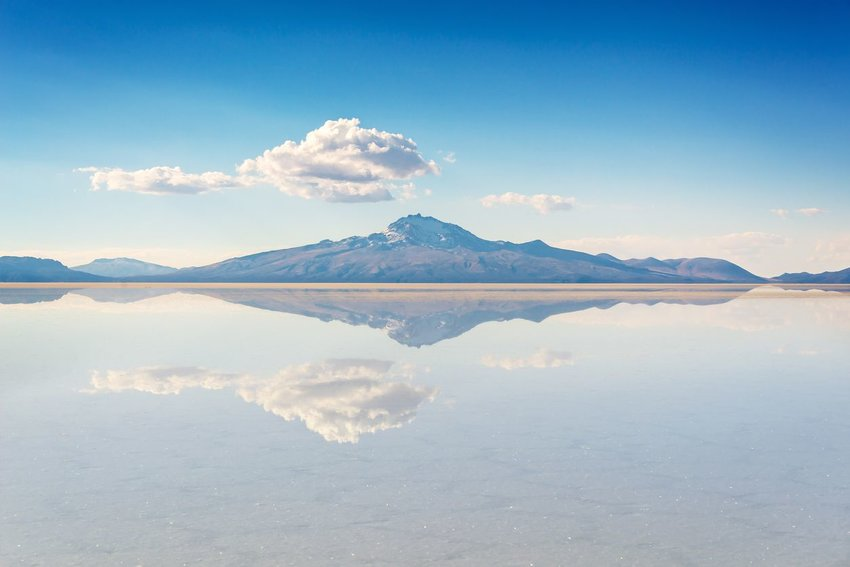 Mirror effect and reflection of mountain in Salar de Uyuni