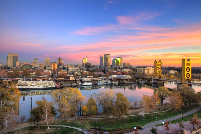 Aerial view of river and downtown Sacramento at sunset