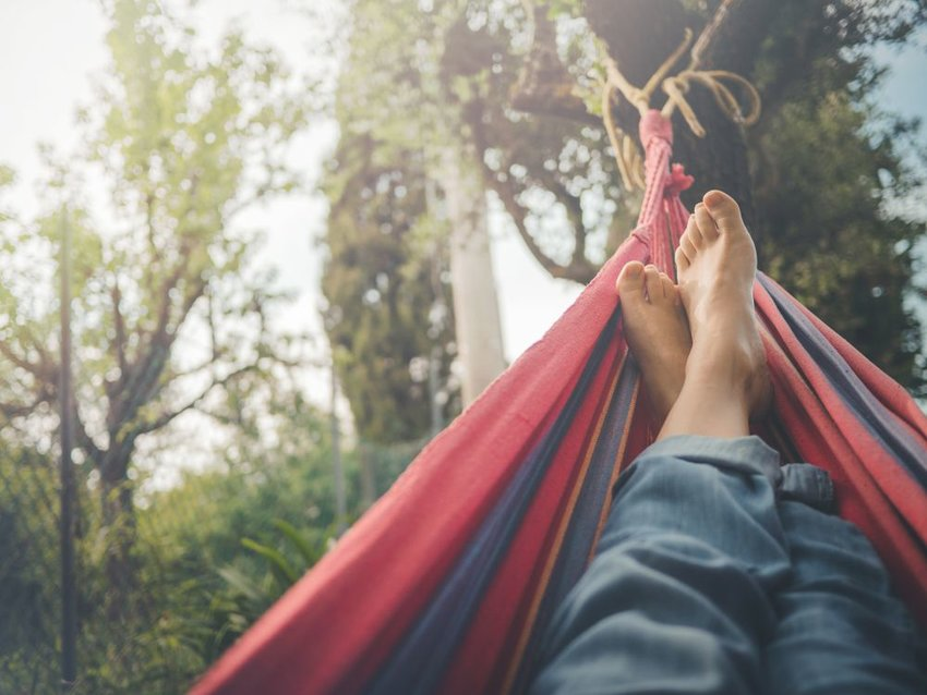 Person resting in a multicolored hammock