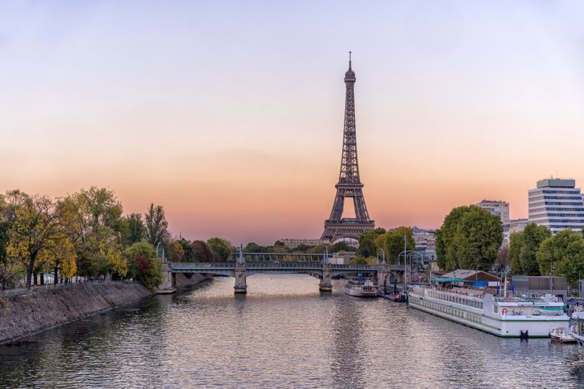 Eiffel Tower at sunset with canal in front