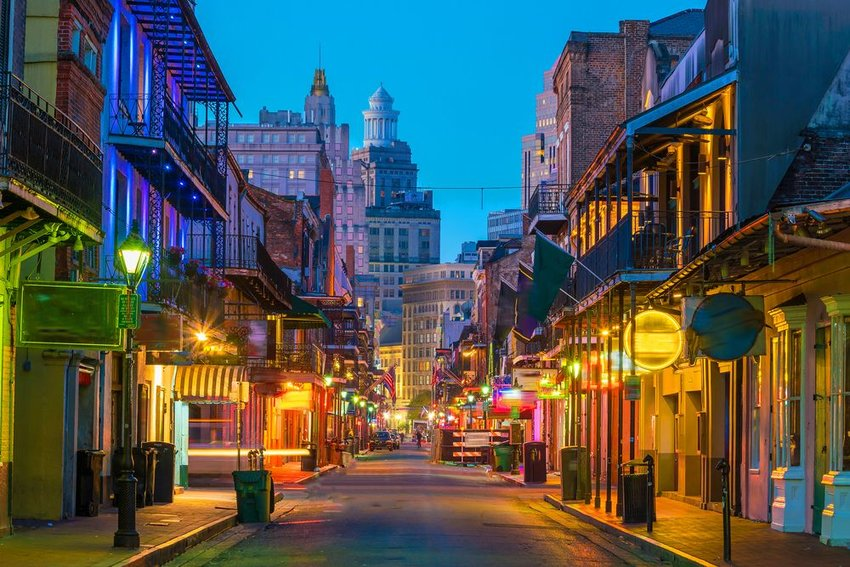 View down street with lights on in the French Quarter