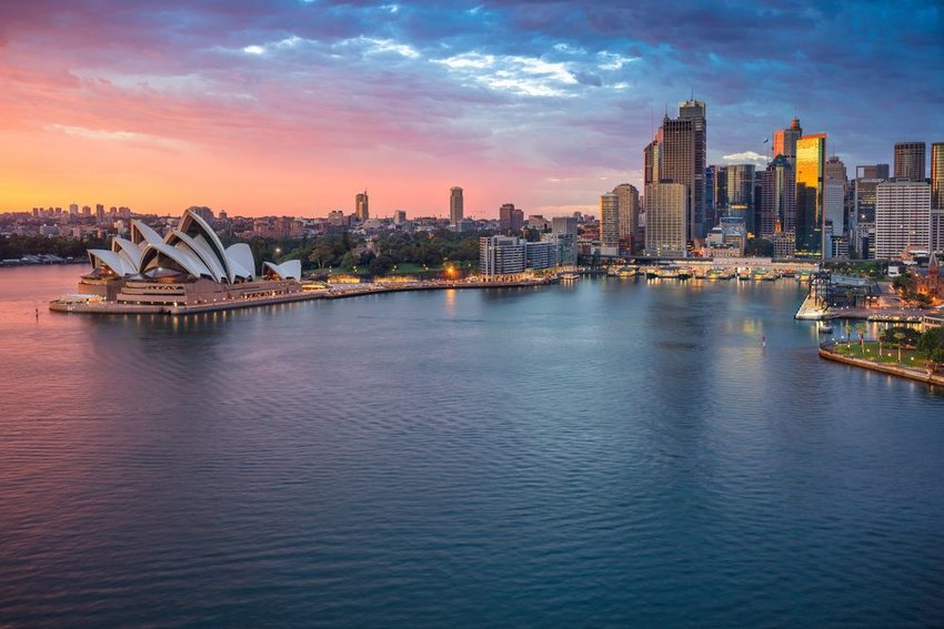 Sydney Opera House at sunset with city in background