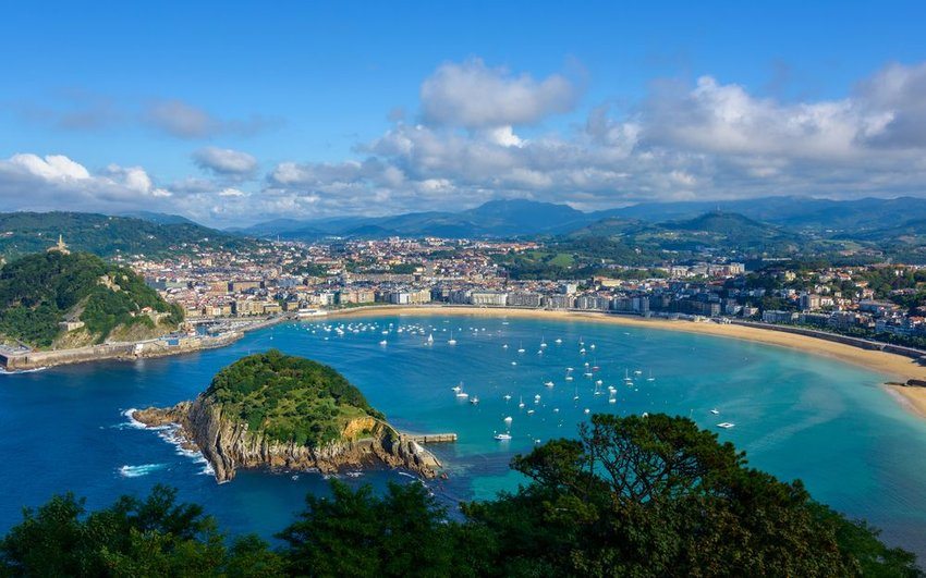 Aerial view of distant San Sebastian under cloudy skies in the Basque Country, Spain