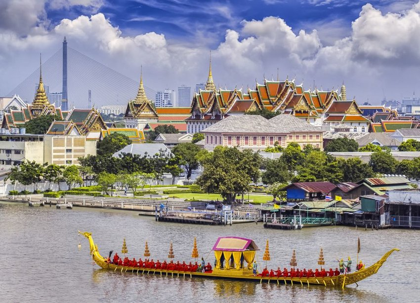 Aerial view of scenic palace, river barges and architecture in Bangkok, Thailand