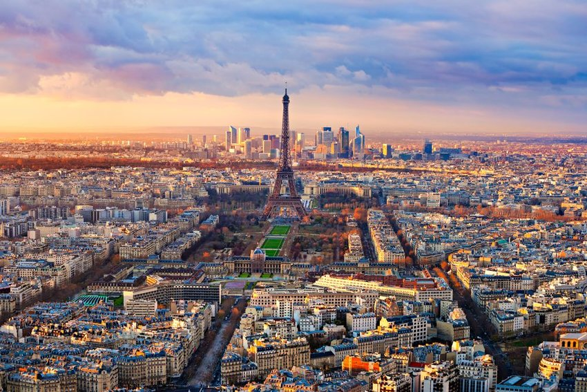 Aerial view of scenic Parisian skyline at sunset, showing buildings and Eiffel Tower
