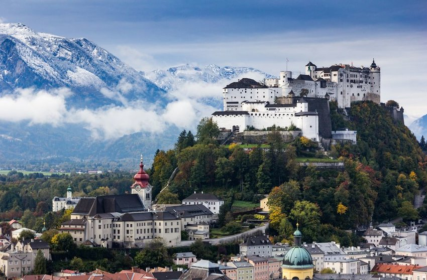 Aerial view of scenic architecture in front of snowy mountains, Salzburg, Austria