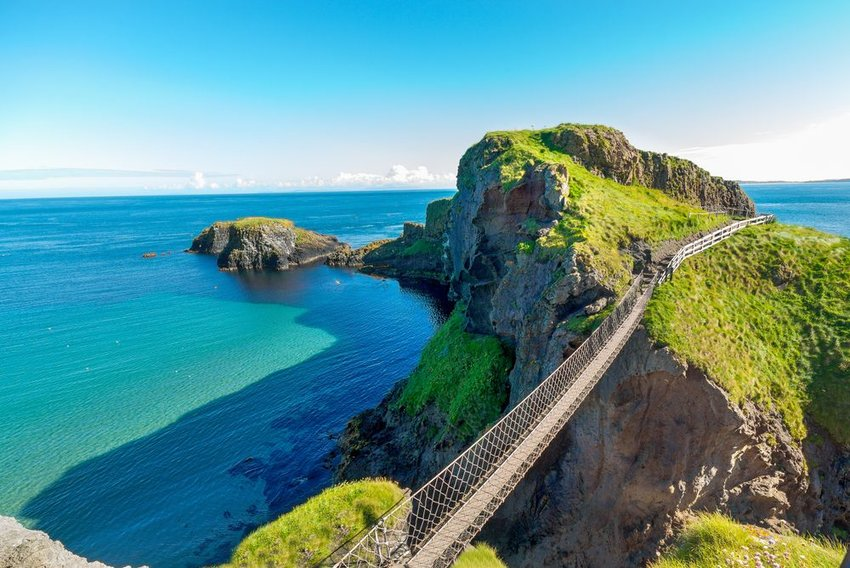 Aerial view of Carrick-a-Rede rope bridge in Northern Ireland, seen under clear skies