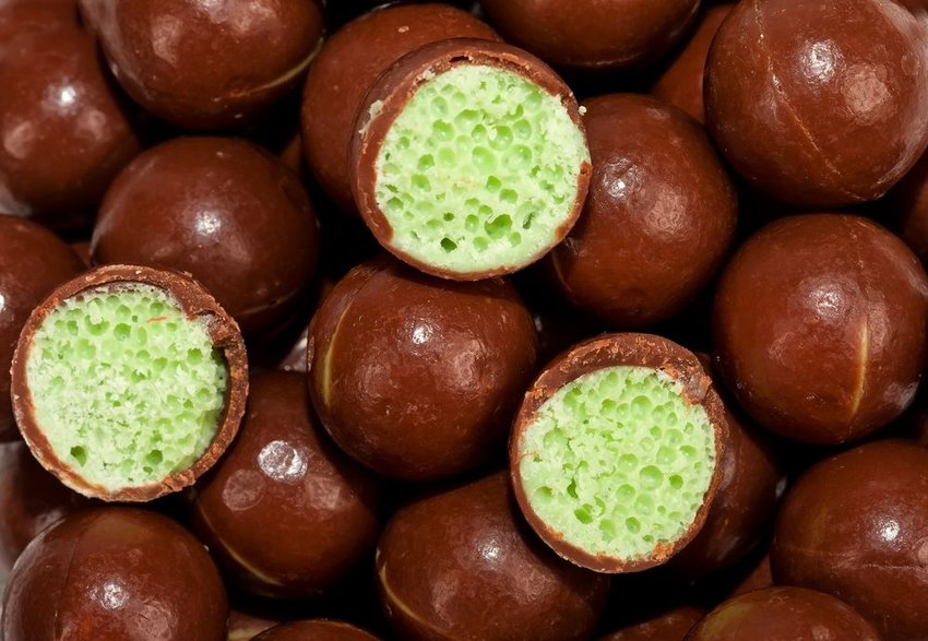 Up close view of chocolate balls showing view of airy interior