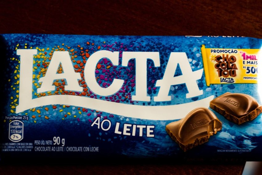 Lacta chocolate bar packaging showing details and shiny reflective surface