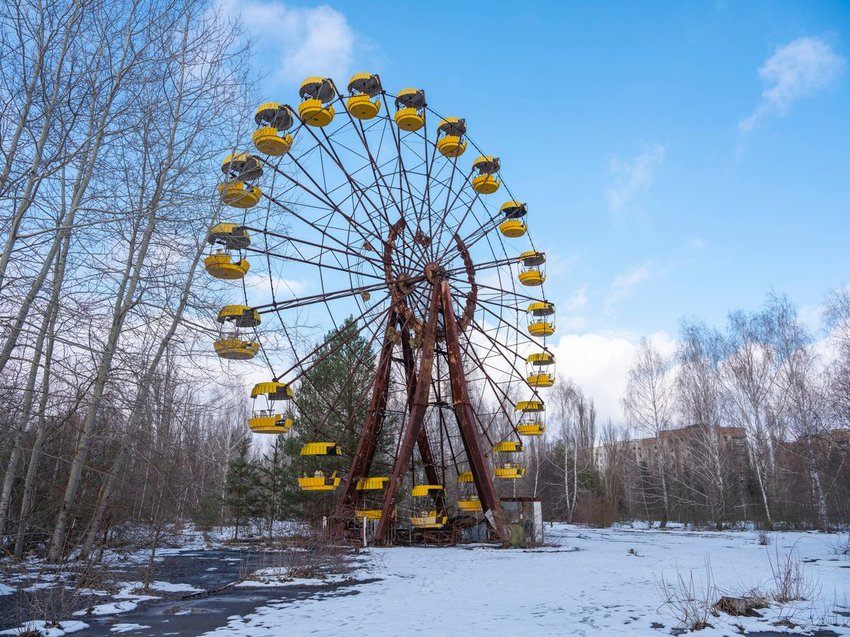 Abandoned ferris wheel in the snow