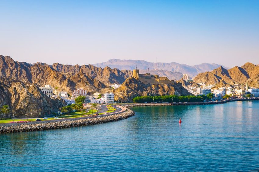 Road winding along waterfront in Muscat, Oman