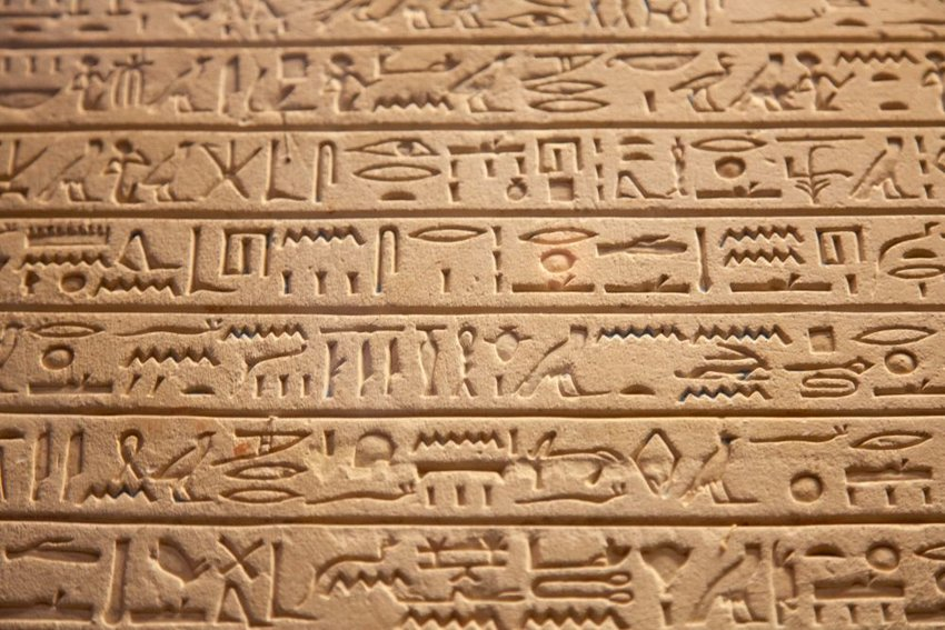 Egyptian hieroglyphs carved into stone