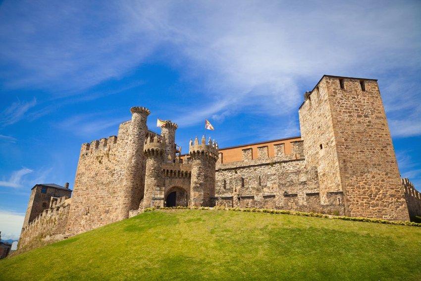 Templar Castle on a hill of green grass
